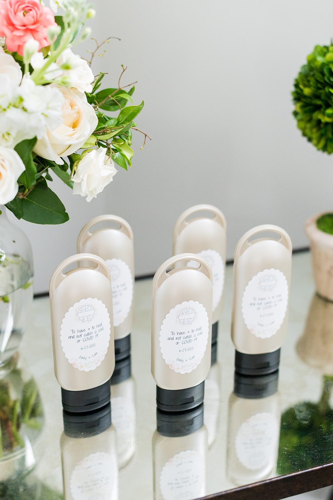 A couple pivoted during COVID-19 times for their wedding at The Lodge at Mount Ida Farm in Charlottesville, Virginia. Pictures by Mikkel Paige Photography of custom hand sanitizer favors for guests. #mikkelpaige #customhandsanitizer #weddingfavors