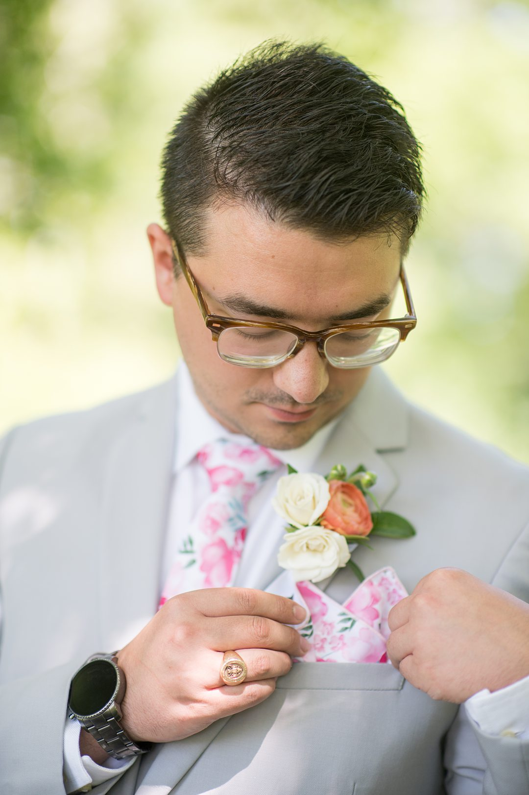 Groom in a grey suit with a pink floral tie and pocket square for a small wedding in Charlottesville, VA during COVID. Photos by Mikkel Paige Photography.
