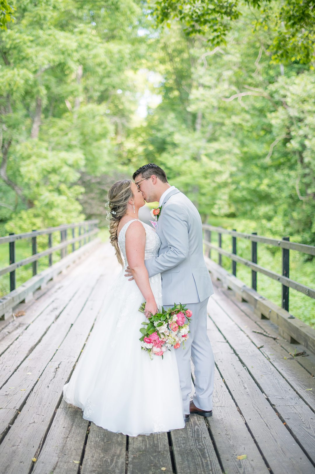 Bride and groom in the woods during their Charlottesville, VA wedding at The Lodge at Mount Ida Farm. Pictures by Mikkel Paige Photography.