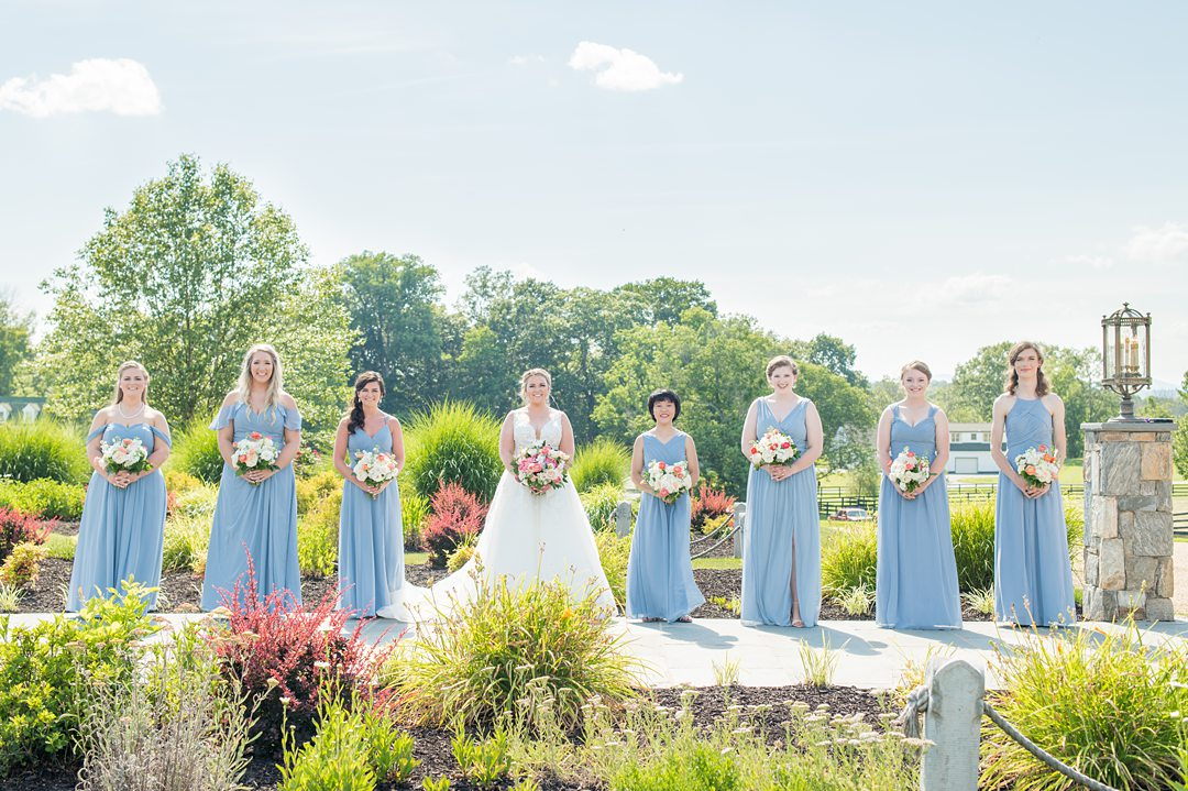 Bridal party in blue gowns for a small wedding in Charlottesville Virginia. Photos by Mikkel Paige Photography at the Lodge at Mount Ida Farm. #mikkelpaige #bridalparty #mountidafarm #charlottesvillewedding