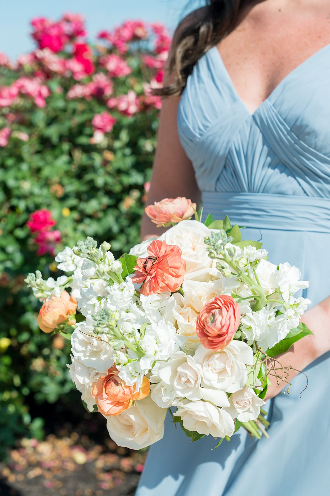 Bridesmaid bouquet of white and peach flowers including hydrangea and ranunculus, for a small wedding in Charlottesville, VA. Mikkel Paige Photography took pictures at The Lodge at Mount Ida Farm. Planning by Mary Elizabeth Events.