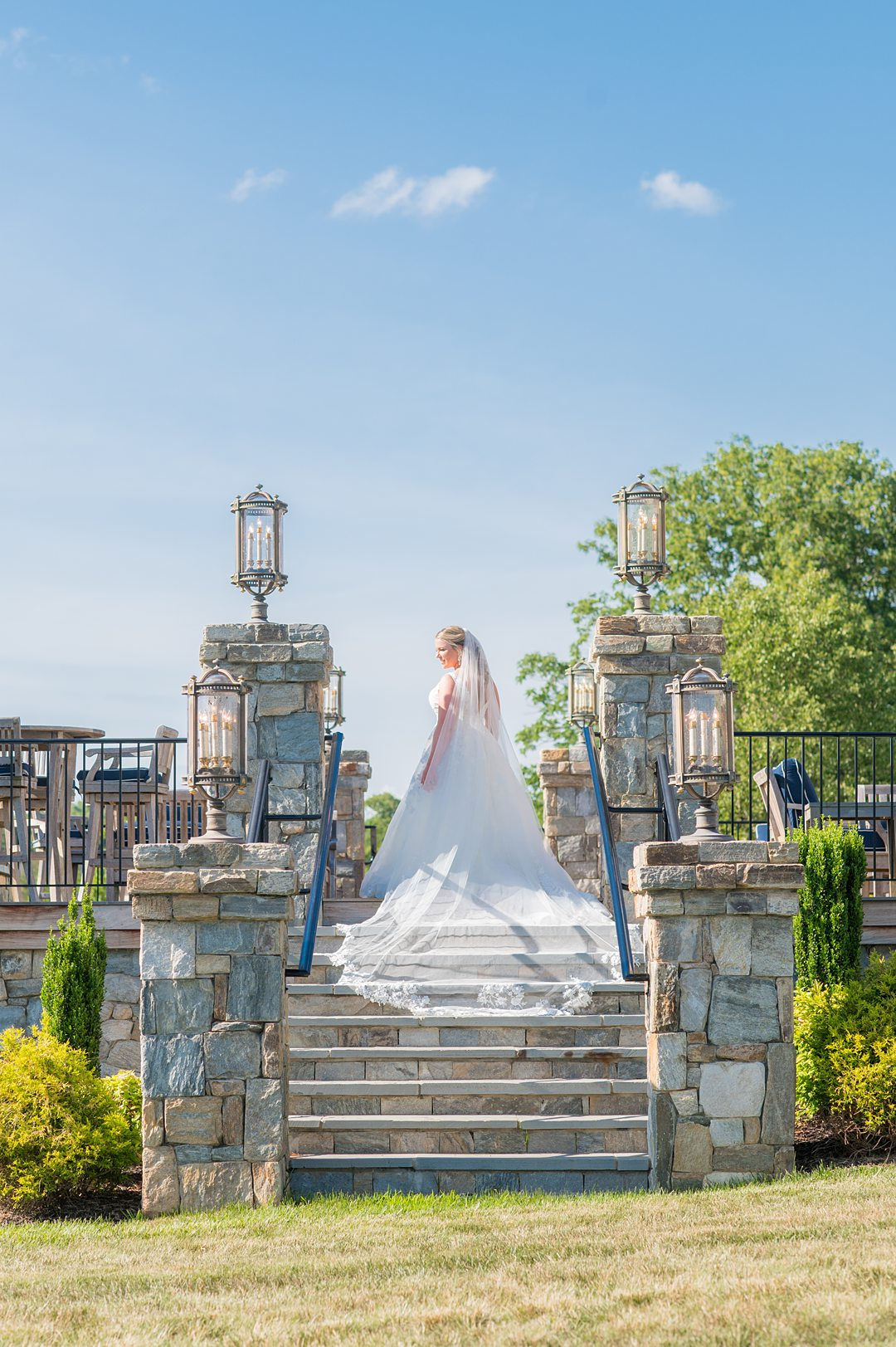 The bride wore a long veil for her wedding at The Lodge at Mount Ida Farm. Photographed by Mikkel Paige Photography.