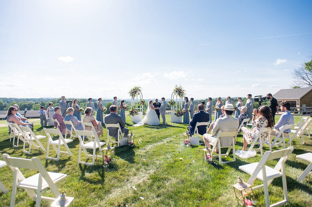 Socially distanced ceremony overlooking the Blue Ridge Mountains at the Lodge at Mount Ida Farm. Photos by Mikkel Paige Photography. #mikkelpaige #smallwedding #charlottesvillewedding