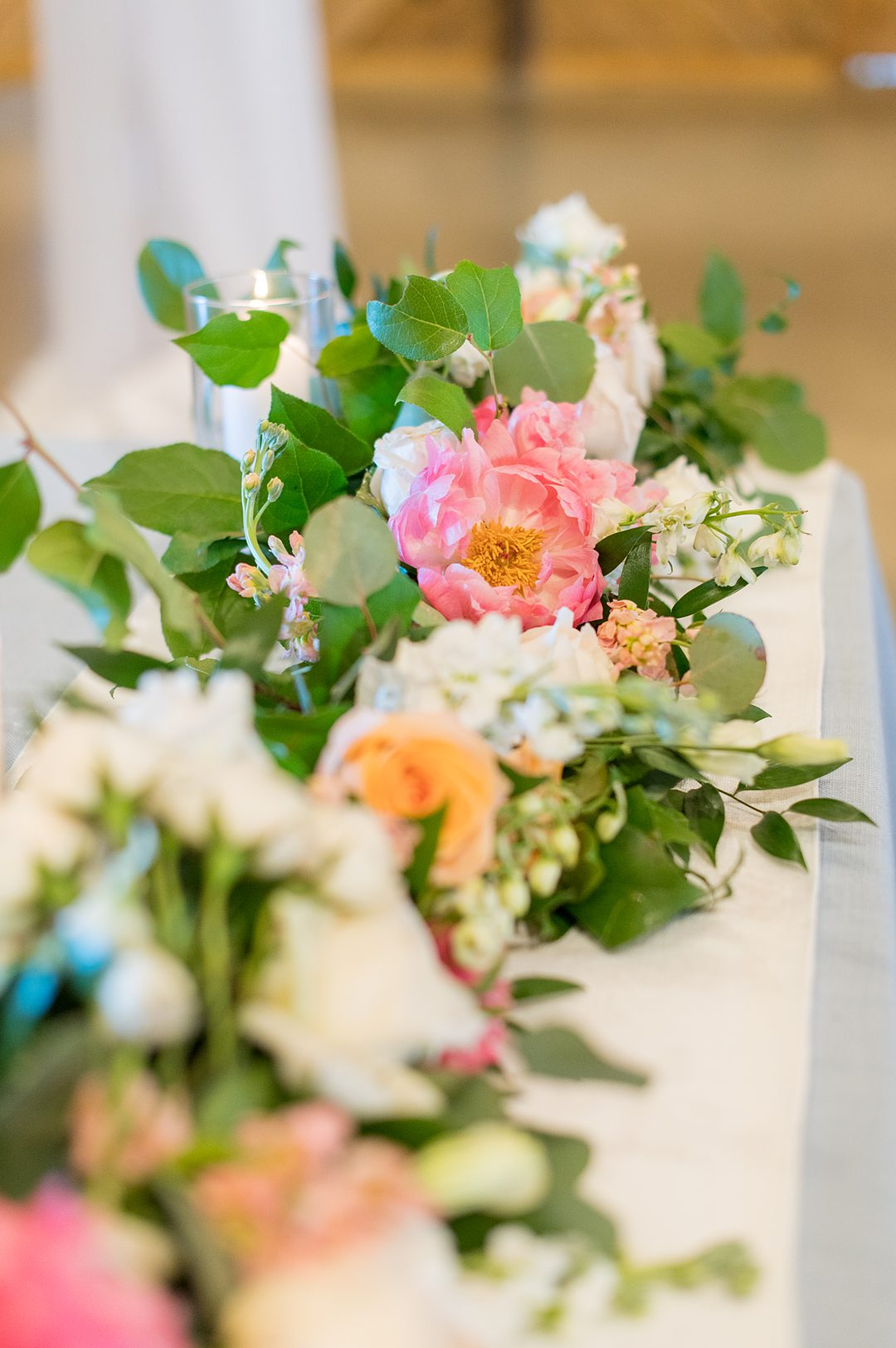 Photos of the table flowers taken by Mikkel Paige Photography for a summer wedding at The Lodge at Mount Ida farm. #peonies #mikkelpaige #weddingreception #charlottesvillewedding