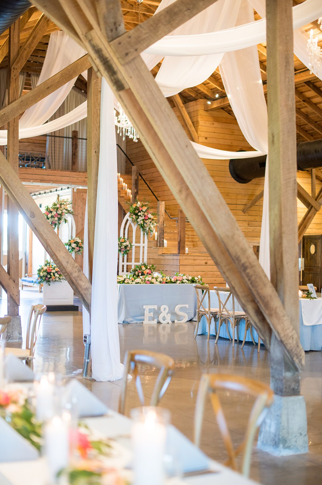 A socially distanced small wedding reception in a barn at the Lodge at Mount Ida Farm, in Charlottesville, VA. Photos by Mikkel Paige Photography. #mikkelpaige #covidwedding #charlottesvilleva
