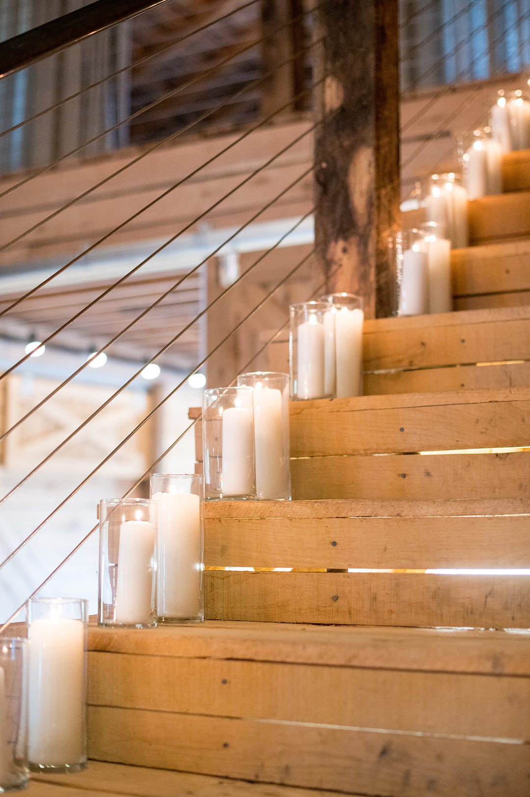 Candles lined the stairs at a small wedding reception at The Lodge at Mount Ida Farm in Charlottesville, VA. Photos by Mikkel Paige Photography. #mikkelpaige #charlottesvillewedding #CharlottesvilleVA #MountaIdaFarm #weddingreception