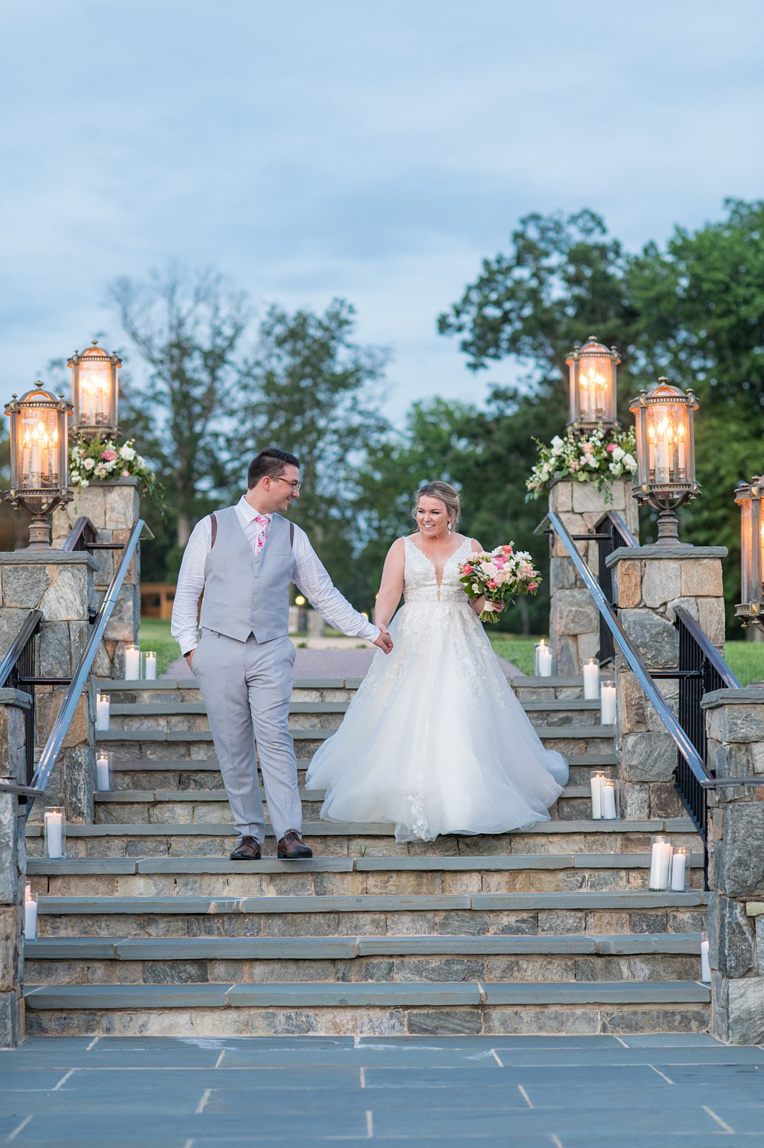 Dusk photo on the stairs of tThe Lodge at Mount Ida farm with the bride and groom surrounded by candlelight by Mikkel Paige Photography. Planning by Mary Elizabeth Events. #charlottesvillewedding #mikkelpaige #duskphotos #brideandgroom