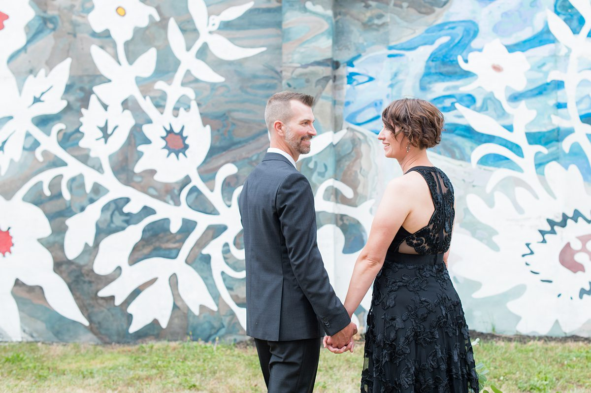 Bride and groom in front of a mural in Harrisburg, Pennsylvania