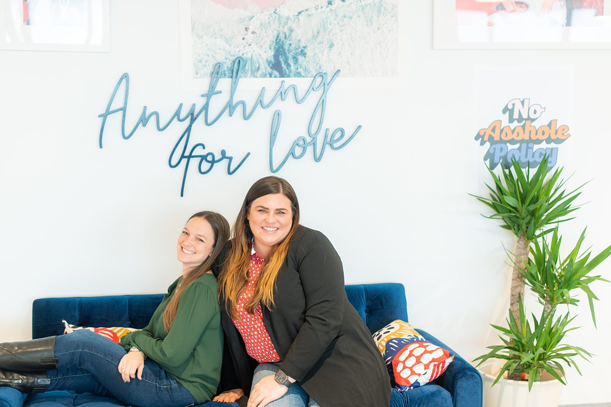 """""""Anything for Love"""" on a wall at Zola Headquarters. A look behind the scenes of the wedding website and app by Mikkel Paige Photography."""
