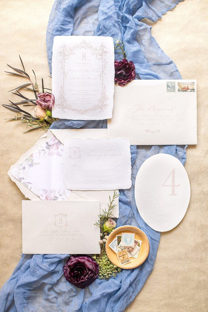 Italian inspired wedding invitation by Longest Time Design with tan, blue and floral elements.